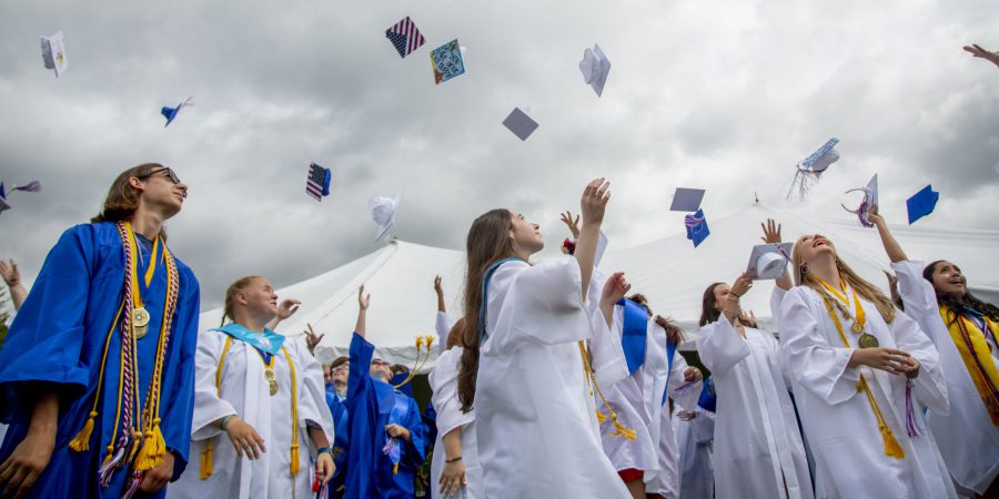 Graduates toss their caps in to the air