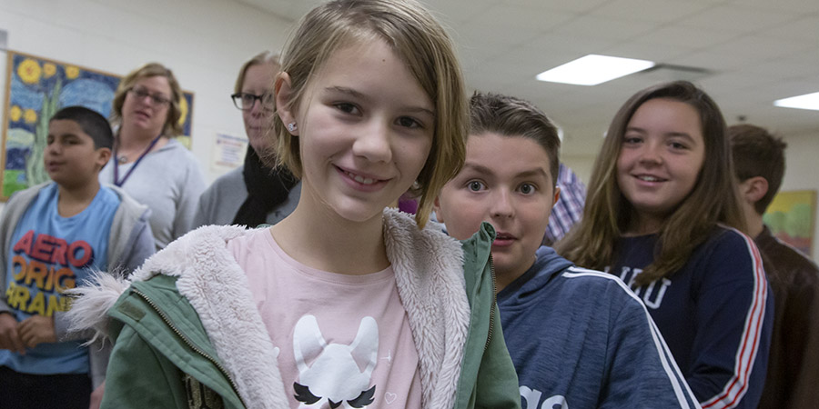 Two elementary students smile at the camera